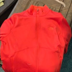North face zip up. Never worn.